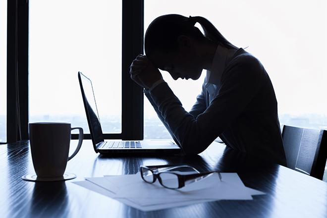 depressed women in a boardroom