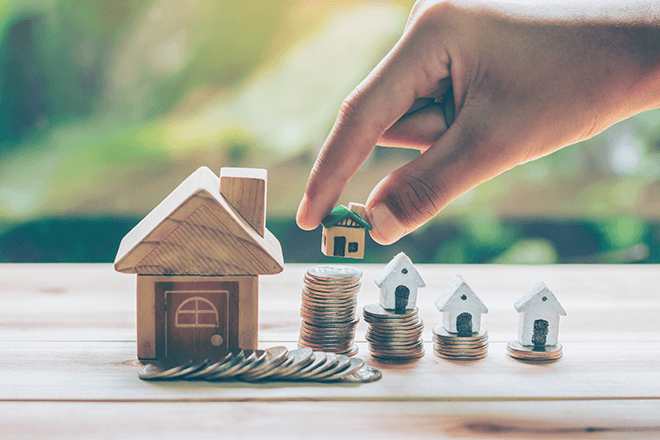 coins, savings and toy homes